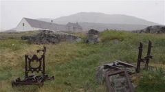 Abandoned building with rusted cast iron equipment in the foreground during a Stock Footage
