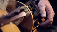 Stock Video Footage of man playing old accordion called Sanfona Hurdy-gurdy stringed musical instrument