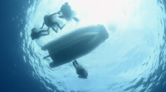 Scuba divers jumping from boat - underwater shot Stock Footage