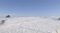 An expedition at Admiralty Inlet exiting camp and heading out on the sea ice on Stock Footage