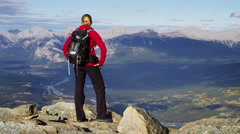 Active young female trekking on a mountain range in Canada - stock footage