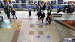 Metro train door open, people alight from carriage, rush on platform, top view Stock Footage