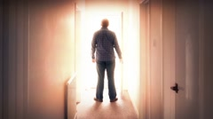 Man Walks Through Door Into Bright Light - stock footage