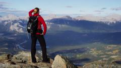 Active young female trekking on a mountain range in Canada Stock Footage