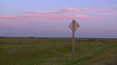 Sunset over a field in Alberta. Pan - stock footage