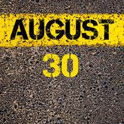 30 August calendar day over road marking yellow paint line - stock photo