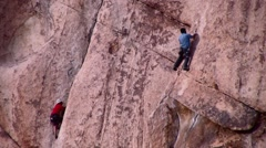 Desert Rock Climbers Joshua Tree Nat. Park California - stock footage