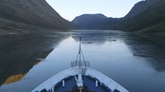 Bow of a cruise ship surrounded by the Torngat Mountains, Newfoundland & Stock Footage