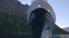 Traveling shot around an arctic cruise ship surrounded by the Torngat Mountains. Stock Footage