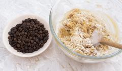 Chocolate chips to be added to cookie dough - stock photo