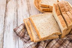 Whole wheat bread on white wooden background Stock Photos