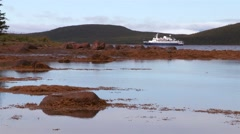 Cruise ship anchored in Torngat Mountains area Fjord. Stock Footage