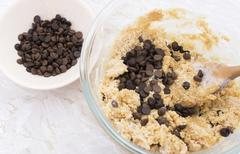Adding chocolate chips to cookie dough Stock Photos