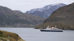 Anchored cruise ship in Torngat Mountains area Fjord. Stock Footage