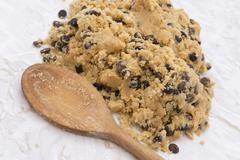 Wooden spoon with chocolate chip cookie dough - stock photo