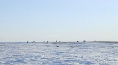 Ski-doos crossing the frozen arctic tundra. Stock Footage