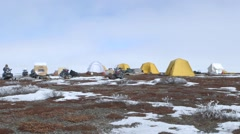 An expedition team campsite in arctic tundra. - stock footage