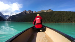 View of female Kayaking Lake Louise Alberta Canada - stock footage