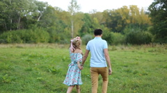Young couple in love together on nature in summer Stock Footage