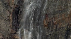 Waterfall running down an Arctic cliffside. Zoom Stock Footage