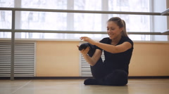 Young girl doing a work-out in the dance hall. making stretching exercise Stock Footage
