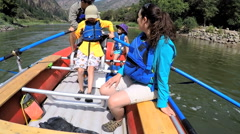 Happy Caucasian family having fun adventure trip on Colorado River outdoors - stock footage