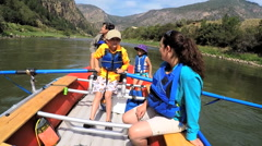 American Caucasian parent and children enjoying rafting on holiday - stock footage