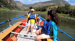 American Caucasian parent and children rafting on Colorado River outdoors - stock footage
