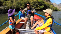 American Caucasian parent and children enjoying rafting on Colorado River - stock footage