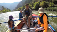 Happy Caucasian family having adventure together rafting on Colorado River - stock footage