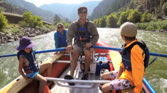 Happy American family rafting on Colorado River on Summer vacation outdoors - stock footage