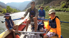 Caucasian family having fun together rafting on Colorado River on vacation - stock footage