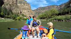 Happy Caucasian family enjoying rafting on Colorado River on vacation outdoors - stock footage