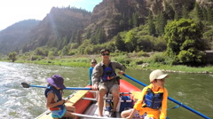 Happy Caucasian family having fun trip on Colorado River on holiday - stock footage