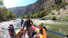 American Caucasian family rafting together on Colorado River on holiday outdoor - stock footage