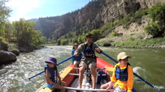Happy family having fun adventure trip on Colorado River on vacation outdoors - stock footage