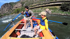 Happy American family enjoying rafting on Colorado River on vacation outdoors - stock footage