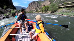 Confident American Caucasian family rafting on Colorado River on Summer holiday - stock footage