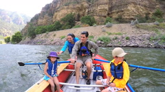 Happy Caucasian family rafting on Colorado River on weekend outdoors - stock footage