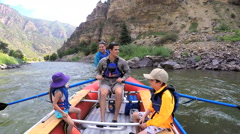Happy American Caucasian family rafting on Colorado River on vacation outdoor - stock footage