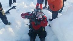 Arctic scuba diver preparing for the dive. Stock Footage