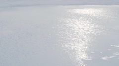 Water rolling across frozen Arctic landscape next to an expedition camp. Pan Stock Footage