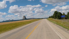 POV driving Devils Tower a National Monument in Wyoming USA Stock Footage