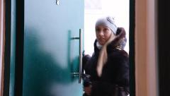 Blond woman opening a door - stock footage