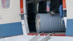 Unloading of jet fuel from a snow plane. Pan Stock Footage