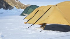 Time lapse of four Arctic tents blowing in the wind. Stock Footage
