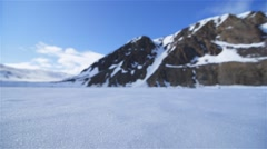 Woman walking to an expedition base camp in the Arctic tundra. - stock footage