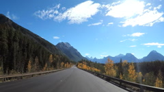 POV road trip mountain driving Icefields Parkway in Canada Stock Footage