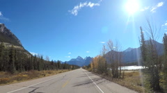 POV road trip driving by river Icefields Parkway in Canada - stock footage
