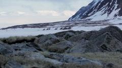 An Arctic mountain range towering over Nunavut tundra. Stock Footage
